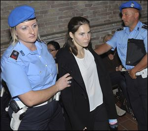 Amanda Knox, center, is escorted to the Perugia court, Italy, Monday, Sept. 26, 2011.