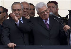 Palestinian leader Mahmoud Abbas, with his arm extended, tells supporters on the West Bank that they are part of a 'Palestinian spring.'