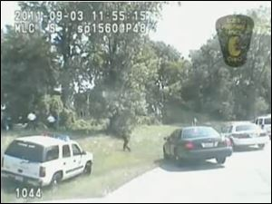 An image of police chasing Brian Lipp from a Toledo police officer's dashboard camera.