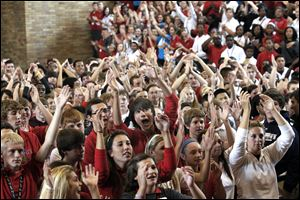 "Central Catholic High School student Derrick Johnson, center with arm raised, and eighth graders from Joan of Arc, Regina Coeli, and St. John the Baptist schools leave Central Catholic High School enjoy a pep rally during  ""Discovery Days,"" at Toledo's six Catholic high schools on September 28, 2011."