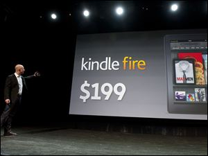 Amazon.com CEO Jeff Bezos unveils the new Kindle Fire tablet at a September 28, 2011 press event in New York City.