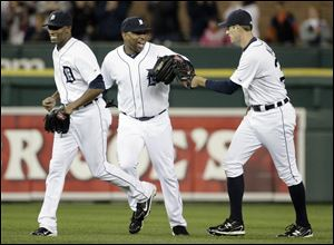 Detroit Tigers outfielders, from left, Austin Jackson, Delmon Young and Don Kelly celebrate a 5-4 win over the Cleveland Indians.