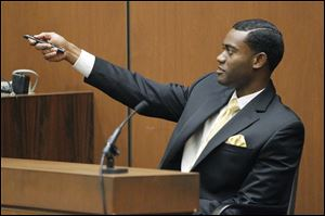 Michael Jackson's personal assistant, Michael Amir Williams, testifies during the second day of Conrad Murray's involuntary manslaughter trial in the death of pop star Michael Jackson in downtown Los Angeles,  Wednesday, Sept. 28, 2011.