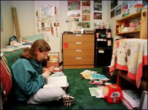 Ohio State University student Susu Behee, of Fremont, Ohio, studies in her dorm room in this 1999 file photo