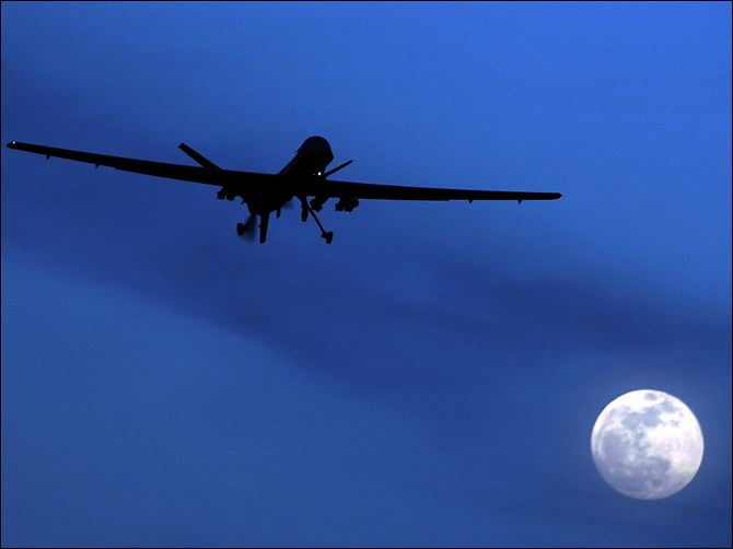 Kandahar Air Field drone moon An unmanned U.S. Predator drone flies over Kandahar Air Field, southern Afghanistan, on a moon-lit night in January, 2010.