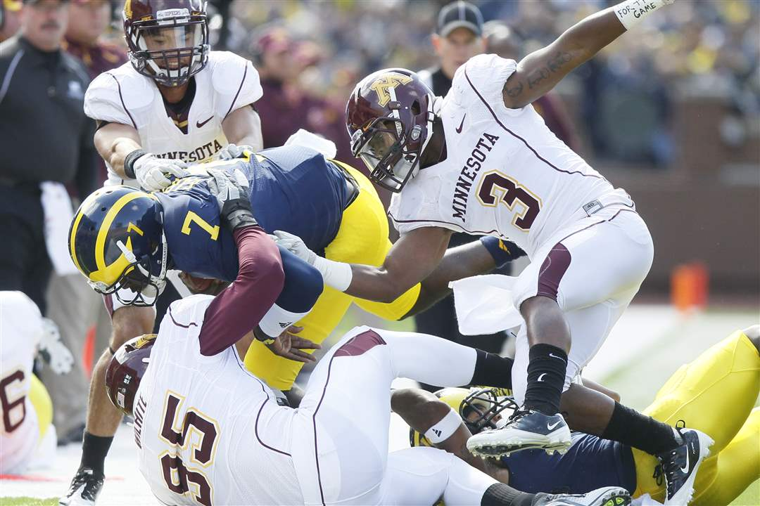 Michigan-s-Devin-Gardner-is-dragged-toward-the-sidelines