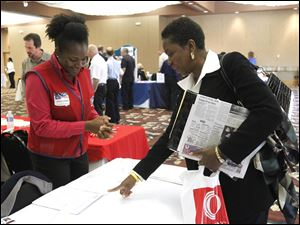 Siccorah (cq) Whitlow, left, Human Resources Manager at Lowe's speaks with Beverly Barnhill, right, from Toledo, during a job fair for job seekers 50 years old and above at The Pinnacle in Maumee on October 4, 2011.