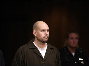 Kevin Wolever, the Toledo man accused of attacking a fire station in East Toledo, stands in Toledo Municipal Court September 16, 2011.