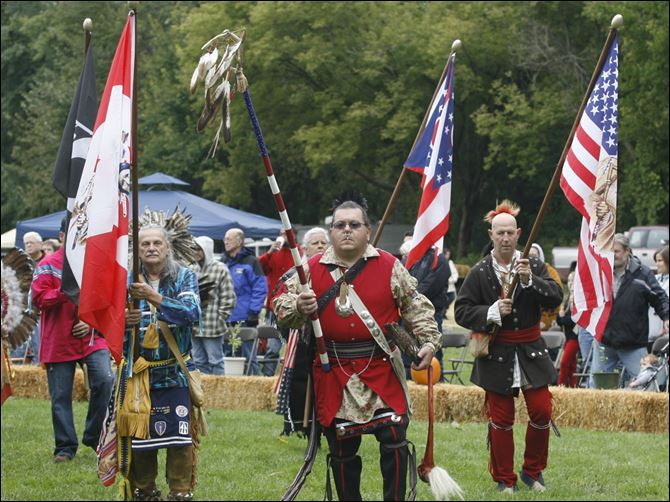 Joe Gutshall of Dunkirk, Ind., left, carries a special flag of Canada and the people of the first nations, left; Brian Darst of Sedalia, Ohio, carries the 9-11 eagle staff; and Don Holsinger of Archbold, carries a special flag of the U.S. and native Americans.