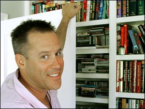 Best-selling author Vince Flynn is shown in the library of his Edina, Minn., home Sept. 2, 2005.