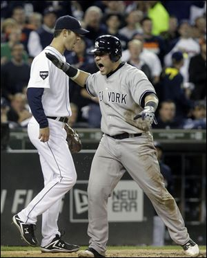 New York Yankees' Russell Martin reacts after scoring on a Derek Jeter double to center field during the third inning of Game 4 of baseball's American League division series against the Detroit Tigers on Tuesday, Oct. 4, 2011, in Detroit.