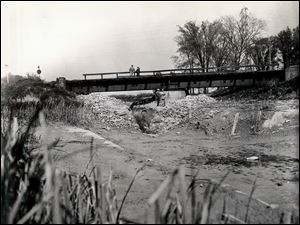 This photo dated May 22, 1935 shows the Canal Boulevard project, south of the Toledo Terminal Railroad trestle.