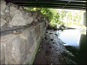 The stone remains of the Erie Street Swing Bridge foundation still remain from the canal era.