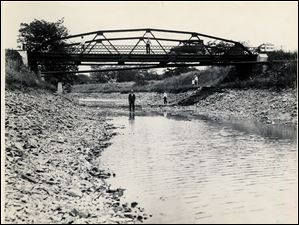 This July 6, 1929, photo shows the Miami & Erie Canal bridge at Roche de Bouf in Waterville, Ohio, looking downstream.