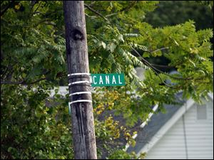A sign marks Canal Avenue which runs along the Anthony Wayne Trail in South Toledo.