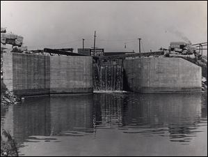 Miami & Erie Canal Lock 52 at Erie Street at taken from the foot of Newton Street about 1900.