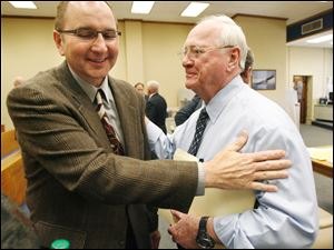 Robin Horvath, left, and Bob Bennett exchange pleasantries after Judge Gene Zmuda chose Bennett's TP Foods offer  for the Tony Packo's Inc. restaurant chain  Thursday.