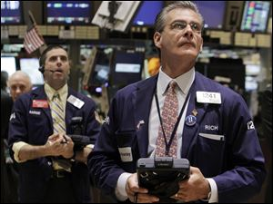 Traders Stephen Guilfoyle, left, and Richard Deviccaro, work on the floor of the New York Stock Exchange.