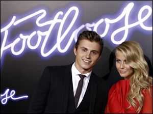 "Cast members Kenny Wormald, left, and Julianne Hough pose together at the premiere of ""Footloose"" in Los Angeles, Monday."