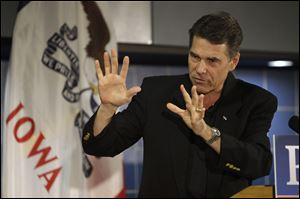 Republican presidential hopeful Texas Gov. Rick Perry speaks Friday during the Johnson County GOP Fall BBQ at Clear Creek-Amana High School in Tiffin, Iowa.