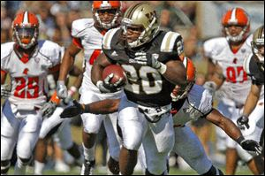 Western Michigan University's Brian Fields runs away from the  Bowling Green defense during the game at Waldo Stadium in Kalamazoo, Michigan, Saturday.