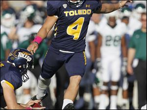 University of Toledo kicker Ryan Casano, 4, kicks a field goal in the third quarter.