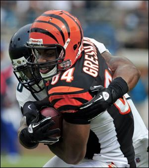 Cincinnati Bengals tight end Jermaine Gresham (84) is tackled by Jacksonville Jaguars free safety Dawan Landry (26) the fourth quarter of an NFL football game, Sunday.