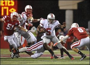 Ohio State's Braxton Miller works his way through the Nebraska defense. He was later injured in the Cornhuskers' first Big Ten home game.