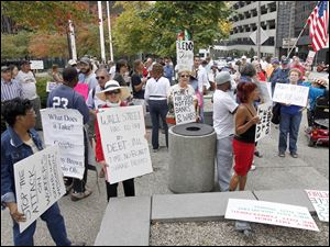 Rally participants carry signs and chant slogans during an Occupy Toledo event.