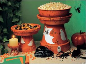 Embellish your Halloween party buffet by transforming ordinary terra cotta pots into spooky party servers.