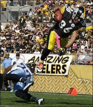 Pittsburgh receiver Hines Ward heads to the end zone over Tennessee safety Michael Griffin, scoring a touchdown during the third quarter of the Steelers' 38-17 victory Sunday.