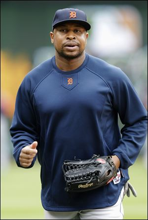 Detroit's Delmon Young jogs onto the field before Game 2 of the ALCS on Monday. A muscle injury kept him out of Game 3 last night.