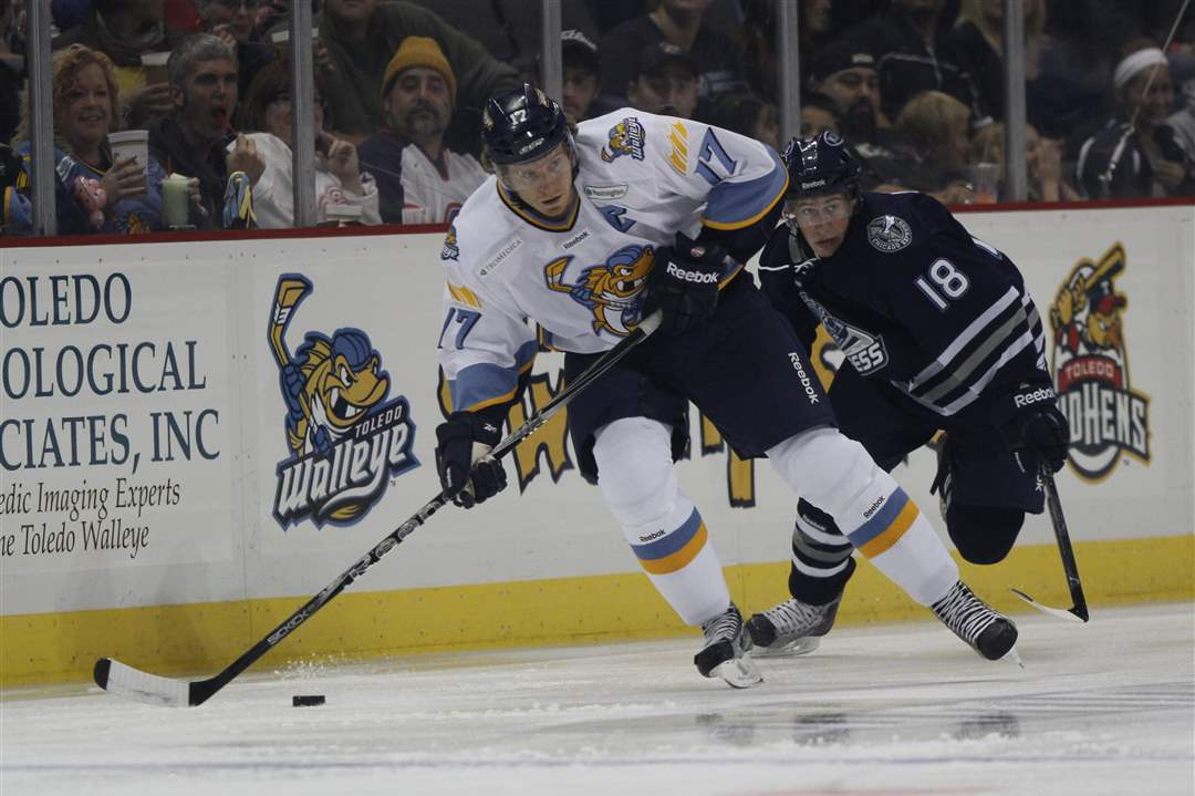 Walleye-player-Kyle-Rogers-17-brings-the-puck-up-the-ice-against-Express-player-Tyler-Johnson