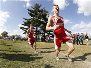 Bowling Green High School runners Marshall Kobylski, left, and Brian Seymour, right, lead the early stages of the race at the Northern Lakes League cross country championship meet at Pearson Metropark in Oregon, Saturday. Kobylski finished 5th and Seymour was 4th.