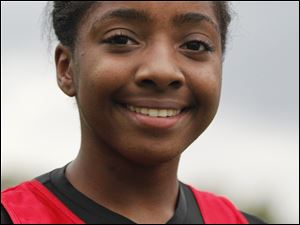 Treasure Jacobs, of Rogers, who won the City League cross country meet at Collins Park Golf Course in Toledo.