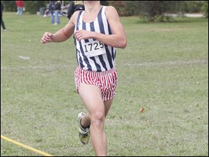 St. Francis de Sales HIgh School's Kyle Lach, a junior, places first in the TRAC cross country meet at Pearson Park in Oregon.