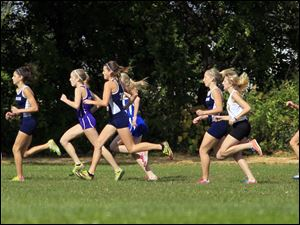The girls varsity race kicks off at the Northern Lakes League cross country championship meet at Pearson Metropark in Oregon, Saturday.