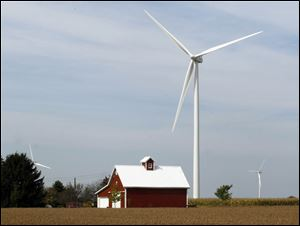 Three wind turbines on farmland in Benton Township are among several in Paulding County.