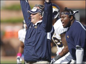 Toledo coach Tim Beckman celebrates after the Rockets stopped Bowling Green on a fourth and one in the fourth quarter.