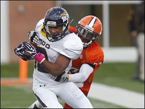 Toledo's Eric Page is brought down by Bowling Green's Aaron Foster.