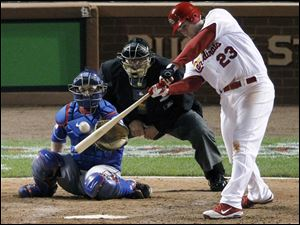 St. Louis Cardinals' David Freese hits a double off Texas Rangers' C.J. Wilson during the sixth inning of Game 1 of baseball's World Series Wednesday.