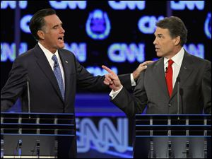 Republican presidential candidates former Massachusetts Gov. Mitt Romney, left, and Texas Gov. Rick Perry square off during a Republican presidential debate Tuesday in Las Vegas.