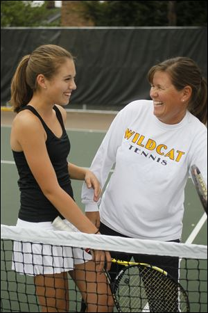 The Blade/Sean WorkMegan Millerand her mother, Susie Miller, share a laugh at Northview High School's tennis courts in Sylvania. Susie is Megan's coach in addition to being her mother.