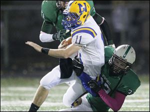 Ottawa Hills' #33, tackles Northwood player Nick Russell, 11.