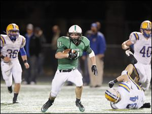 Ottawa Hills player Will Longthorne, 11, finds running room against Northwood.