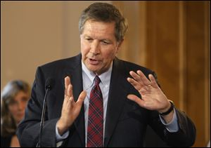 Ohio Gov. John Kasich answers questions during a news conference after he signed an executive order on dangerous exotic pets.