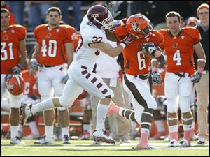 Bowling Green State University player Anthon Samuel (6) is caught by Temple University player Kevin Kroboth (37) during the first quarter Saturday.