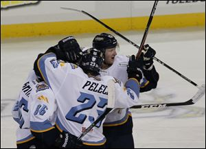 Toledo's Evan rankin, left, Michael Pelech, and Justin Pender congradulate Phil Rauch, in middle, after his third-period goal.