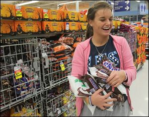 Samantha TenEyck, 17, loads up on candy, even though prices have gone up.