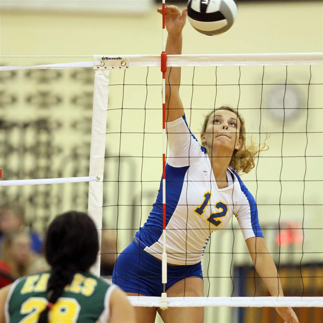 St-Ursula-s-outside-hitter-Madison-Strall-spikes-on-Clay